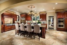 Spacious kitchen with large range and island seating. #kitchen