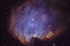 A lesser known sight in the nebula-rich constellation Orion, NGC 2174 can be found with binoculars near the head of the celestial hunter. About 6,400 light-years distant, the glowing cosmic cloud surrounds loose clusters of young stars. Covering an area larger than the full Moon on the sky, this stunning narrow band image adopts a typical color mapping of the atomic emission from NGC 2174.