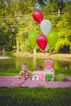 Kindred summer sessions Longview Texas East Tex Watermelon themed little baby girl toddler first birthday party photo posing ideas pose poses for session outside picnic one in a melon romper sister sisters cuteness bday inspiration ideas smash cake melon shaped pink red