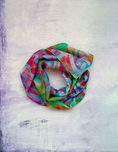 Lightweight long silk scarf with an artistic colourful abstract print. The scarf was digitally printed in the UK using my own design on natural habotai silk and finished in my studio. If you are looking for unique printed scarves for women to comb...