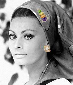 Sofia Loren wearing 1980s Bvlgari earring and brooche