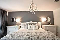 Maybe a darker gray for an accent wall which the bed will be against, because there will be colored accents throughout the bedroom. LOVE