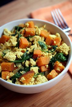 Skip your standard eggs for this flavorful and hearty tofu scramble with kale and sweet potatoes instead. Photo: Jenny Sugar