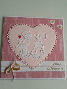 Trouwkaart in roze.wit met hart.paartje en ringen.
