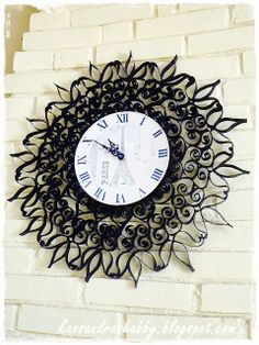 Wrought iron clock made from toilet paper tubes!