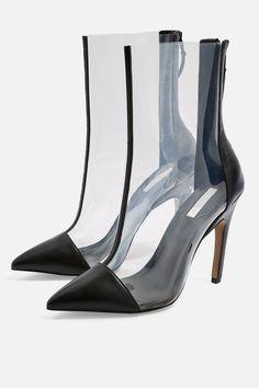 6c537cf7e1a16 Rivet Embellished Platform Transparent Heel Sandals. Channel a  retro-inspired look with our transparent heeled ankle boots. Transparent  Boots
