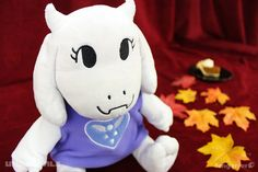 A silly little lady who worries too much.The Toriel plush, prototyped by Fangamer's own Jenna Post, is 10 inches tall and made of a lush micro-minky material, with an embroidered face and Delta Rune. She's wearing a soft micro-fleece robe. Undertale Plush, Undertale Toriel, Fnaf, Hobbies For Women, Toby Fox, Toot, Hobbies And Crafts, Manualidades