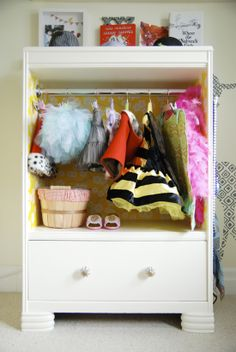 Transform an old dresser or nightstand into a kid sized dress up closet - get the DIY. We could do this with Hudson's armoire!