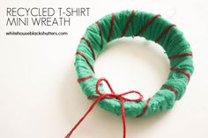 make a recycled mini wreath out of an old t-shirt and a canning jar lid! Recycled T-Shirt Mini-Wreath Ornament  from WhiteHouseBlackShutters.com seen on SewWoodsy.com
