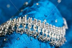 Asian Wedding Jewels on turquoise fabric