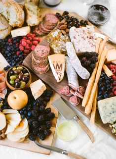 My favorite thing about a wine tasting party is the prep. That might sound weird, but it's fun to put a big beautiful board together full of different fruits, cheeses, proteins, and treats. My approach to building a beautiful spread is to pack it all on.