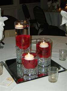 This site has lots of floral/candle arrangements - no info