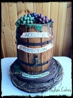 My client said she was having a surprise 50th birthday party for her husband at a winery and wanted a cake to go with that theme. I searched wine ba...