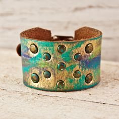 "Turquoise Jewelry Leather Cuff Bohemian Gypsy Hippie by rainwheel  buckle cuff bracelet is handmade from a leather belt. The strip of leather that runs through the metal buckle has six holes punched through it that allows for six different size settings. This cuff will fit a Women's Small to Large wrist sizes. This cuff will fit wrists from 5"" to 8"" around. The width of the cuff is 1 1/2"".  * This cuff will look slightly different under different lighting conditions due to the gold metallic…"