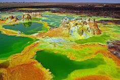 Dallol is a volcanic crater located in the Danokil Desert in Ethiopia. Surrounding the volcano are acidic hot springs, mountains of sulphur, pillars of salt, small gas geysers and pools of acid. Natural Structures, Alien Worlds, Natural Phenomena, Road Trip, Natural Wonders, Hot Springs, Maldives, Wonders Of The World, Cool Pictures