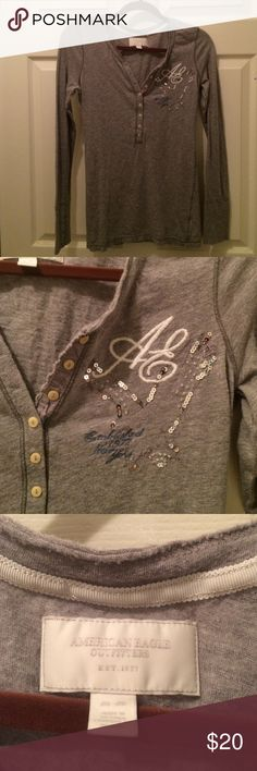 American Eagle long sleeve Henley M Long sleeve button down henley tee. Has AE emroidery and sequin and bead detail. Excellent condition. Size M. American Eagle Outfitters Tops