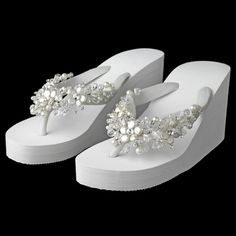 High wedge beach wedding flip flops with crystal and coin pearl decoration.