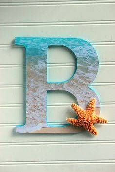 ocean beach themed wooden letter with starfish by seasidetidesshop