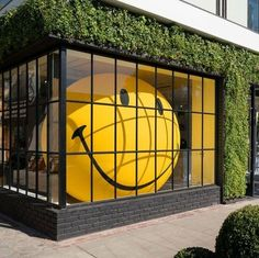 A blow-up smiley face in the window at Anya Hindmarch's new L.A. store | http://archdigest.com