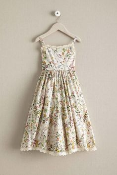 Girls Wildflower Dress is vintage inspired with a sweeping skirt that looks cute with a pretty sweater or denim jacket.