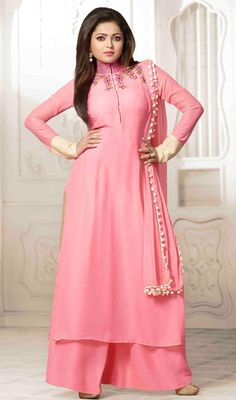 Discover the artistic side as Drashti Dhami by slipping on this pink color embroidered georgette palazzo suit. The lace, mirror, resham and stones work seems to be chic and best for any celebration. #pinkpalazzodres #palazzodresses #bollywoodpalazzosuits