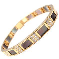 VAN CLEEF & ARPELS Diamond & Mother of Pearl Gold Bracelet. Yellow Gold Diamond & Grey Mother of Pearl Bracelet by Van Cleef & Arpels. With 30 round brilliant cut diamonds, VVS clarity, D color. Cartier Love Bracelet, Pearl Bracelet, High Jewelry, Jewellery, Van Cleef Arpels, Link Bracelets, Jewelry Watches, Fashion Jewelry, Pearls