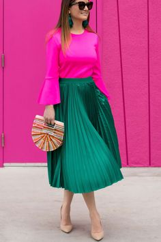 Saguaro Palm Springs Colorful Doors Jennifer Lake Style Charade in a green satin pleated skirt, pink bell sleeve top, Cult Gaia bag, and Steve Madden pumps at the Saguaro Palm Springs colorful doors Satin Pleated Skirt, Green Pleated Skirt, Pleated Skirt Outfit, Dress Skirt, Corset Dresses, Prom Dresses, Green Skirt Outfits, Modest Outfits, Modest Fashion