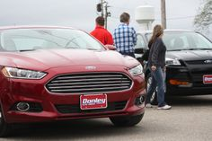 2014 Ford Fusion Titanium in Ruby Red with a 2014 Ford Escape S in Tuxedo Black! Check them out!  http://on.fb.me/1jcE14O