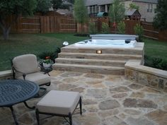 Hot Tub In Backyard Ideas this version is built into a raised stone garden bed and is covered by a curved Hot Tub Idea