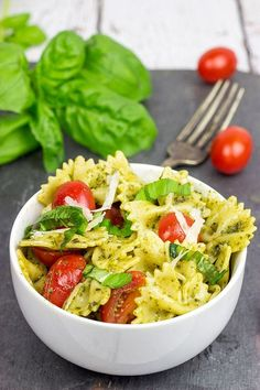 Pesto Pasta with Grilled Chicken. This Pesto Pasta with Grilled Chicken is an easy and delicious weeknight meal. Serve it cold in the summer and hot in the winter! Grilled Chicken Pasta, Grilled Chicken Recipes, Baked Shrimp, Pesto Chicken, Clean Eating Snacks, Healthy Snacks, Healthy Eating, Healthy Recipes For Lunch, Healthy Work Lunches
