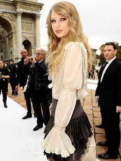 Taylor Swift arrives in Milan for Roberto Cavali's fashion show during fashion week.
