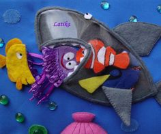 "Love this idea for a clear plastic shark who can ""eat"" the other sea creatures. Fun interactive quiet book page!"