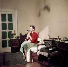 Robert Capa, [Capucine, French model and actress, in her hotel room, Rome], August 1951. © Robert Capa/International Center of Photography/Magnum Photos.