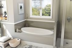 Alcove-sized soaker: Designed to fit in a typical 5 1/2-foot alcove, the oval acrylic Serenity tub has an elongated backrest and armrests, which give the tub a roomy feel despite its modest 63-by-34-inch footprint. From aquaticbath.com