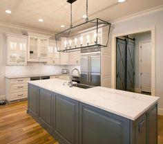 Kitchen Remodel, Grey cabinets, Barn Door, two islands, kitchen lighting ideas, hardwood floors, Wolf Appliances, brick backsplash, custom hood,Transitional Renovation | Walker Woodworking