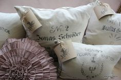 INSPIRATION :: Ideas for pillows w/ stencils or transfers. Looks like these were made out of drop cloth.