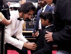 And the two of them together – whoa boy, it's too much for anybody to handle. Here's Dev adjusting his little buddy's tie so that he looks his adorable best for the cameras. | Dev Patel's Reaction To Sunny Pawar At The Oscars Is The Most Pure Thing You'll Ever See
