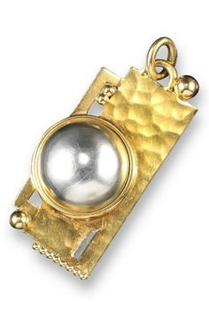 An Art Deco silver and gold pendant by Jean Despres. Of geometric design, the silver semi-sphere set within pierced and textured rectangular gold border. Signed J. Despres with maker's lozenge and French control marks. 5.5cm long. #JeanDespres #ArtDeco #pendant