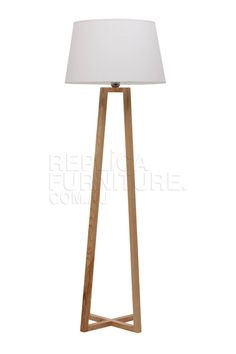 The cross wood base is carefully constructed from solid beech wood, and combined with a good size lamp shade finished in crisp white enhances any living space or office environment. Description from replicafurniture.com.au. I searched for this on bing.com/images