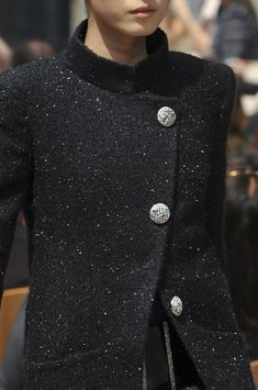 Chanel Fall 2013. Spring or fall jacket with asymmetrical front button closure with stand up mandarin collar and longer length hem with hidden hip pockets.