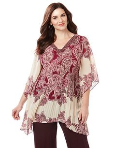 You'll feel like a boho-chic goddess in this dramatic pleated blouse. In a tunic length that pairs perfectly with leggings, it features an intricate paisley print and embellished neckline. The sleeves are the star of the show; perfectly flowy and angel-like, for a free-spirited finish. V-neckline. Three-quarter sleeves. Two-point hem. catherines.com