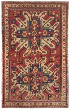 """Caucasian Eagle Kazak (Chelaberd Karabagh), 4ft 5in x 6ft 8in, Dated 1875.  An excellent representative of one of the most illustrious, highly sought after collectible antique Caucasian rug styles, this stunning Eagle Kazak is a very exciting acquisition (a style known by rug scholars as Chelaberd Karabagh.) Consuming much of the field, the overscale """"Sunburst"""" medallions are delightfully asymmetrical, seeming to burst out of the rug's narrow, naively rendered frame."""
