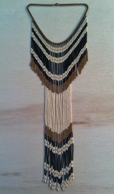 The Hoopoe bird tribe collar is our rendition of the Afro-Eurasian bird species rich with gold, black and ivory