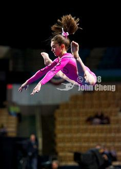 Emily Schild (Australia) on uneven bars at the 2013 American Cup