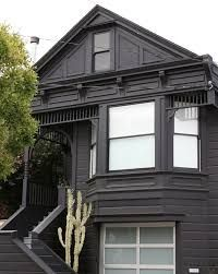 Image result for black weatherboard house with bagged stone details