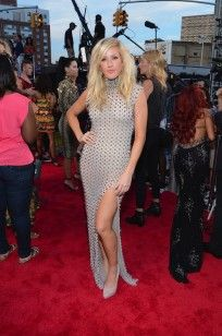 Pin for Later: Red Carpet Rewind: The Most Memorable Looks from Last Year's MTV VMAs Ellie Goulding stood out in an edgy studded dress with a side slit and a high neck. She finished her look with Brian Atwood pumps.Red Carpet Rewind: The Most Memora Ellie Goulding, Miley Cyrus, Katy Perry, Lady Gaga, Selena Gomez, Mtv Video Music Award, Music Awards, Mtv Music, Studded Dress