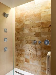 Philadelphia Master Bath k YODER design  Color variations and veining in the shower's Burma Teak stone are accented by its random ashlar pattern.