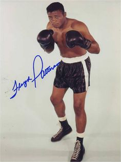 Floyd Patterson (January 4, 1935 – May 11, 2006) was an American heavyweight boxer and former undisputed heavyweight champion. At 21, Patterson became the youngest man to win the world heavyweight title. He was also the first heavyweight boxer to regain the title. He had a record of 55 wins 8 losses and 1 draw, with 40 wins by knockout. He won the gold medal at the 1952 Olympic Games as a middleweight.  Although Mike Tyson later became the youngest boxer to win a world heavyweight title, Pat...