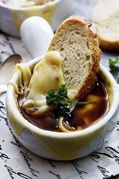 Slow cooker french onion soup - loads of flavor, caramelized onions, and CHEESE! An easy crockpot recipe.