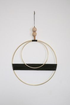 Double Circle With Black Thread Wall Hanging - Young & Able